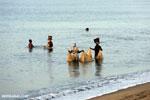 Villagers fishing on a beach in Maroantsetra [madagascar_maroantsetra_0290]