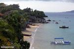 Boats along a beach on Nosy Komba [madagascar_nosy_komba_0112]