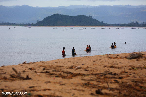 Villagers fishing on a beach in Maroantsetra