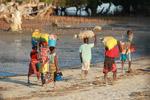 Malagasy carrying goods to market on a beach near Tulear [madagascar_7855]
