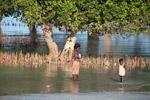 Vezo children walking near mangroves