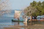 Vezo fisherman setting sail as his children say goodbye