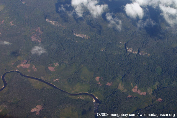 Aerial view of cliffs, forest, and a river
