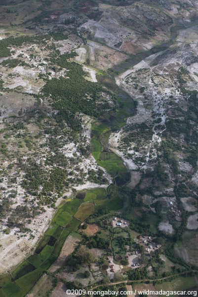 Aerial view of rice paddies, forest degradation, and erosion in southern Madagascar