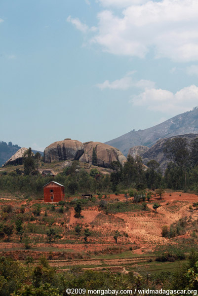 Terraced rice paddies, boulders, and houses in Madagascar