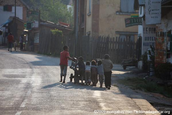 Kids pushing a cart