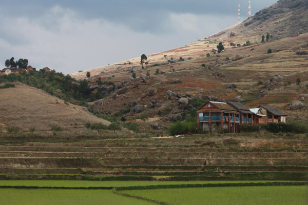 Large Malagasy home and rice fields