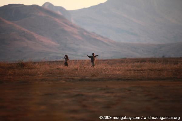 Children walking at sunset near Andringitra