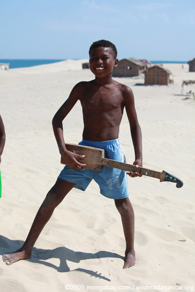 Vezo boy with guitar in Arovana (Ankorohoke)