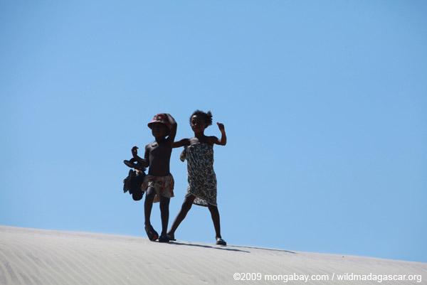 Vezo kids dancing atop a sand dune