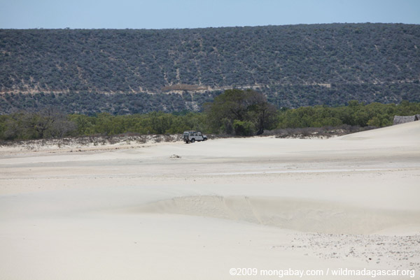 Landrover across a sandy plain