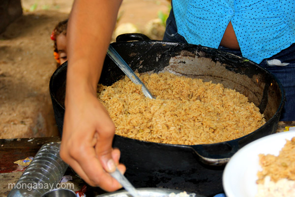 Rice is a staple of a family dinner by the river near Mencia in the Pedernales Province of the Dominican Republic.