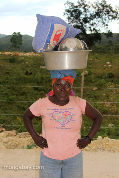 A Haitian refugee carries her goods on her head in the village of Mencia, Dominican Republic.