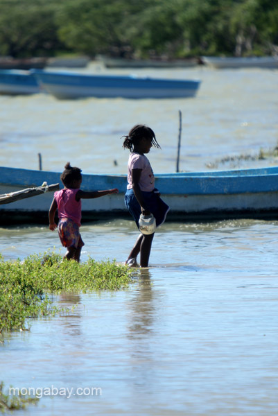 Young children help their parents fish the Oviedo Lagoon in the Dominican Republic.