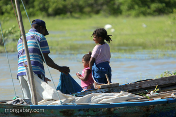 A man and his children fish at Oviedo Lagoon in the Dominican Republic.
