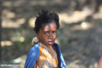 Girl selling mangos alongside a road [madagascar_ankarafantsika_0381]