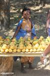 Girl selling mangos alongside a road [madagascar_ankarafantsika_0383]