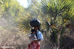 Woman waiting on a roadside in Madagascar