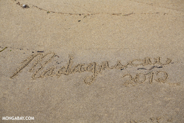 Madagascar written on a beach