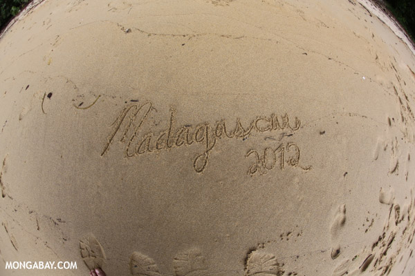 Madagascar written on a beach