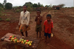 Children selling mangoes along RN6 from Joffreville to Ankarana