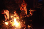 Bara around a camp fire [madagascar_6443]