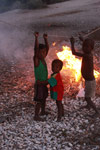 Kids by a fire in a village near Tulear