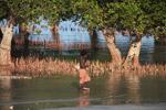 Vezo child walking near mangroves [madagascar_7865]