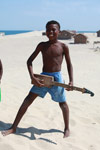Vezo boy with guitar in Arovana (Ankorohoke) [madagascar_7998]