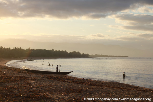 Morning activities on a beach near Maroantsetra with Nosy Mangabe in the background