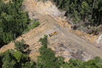 Bulldozer at a conventional logging site in Malaysian Borneo -- sabah_aerial_0654