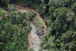 Logs in a river bed in Borneo -- sabah_aerial_1738
